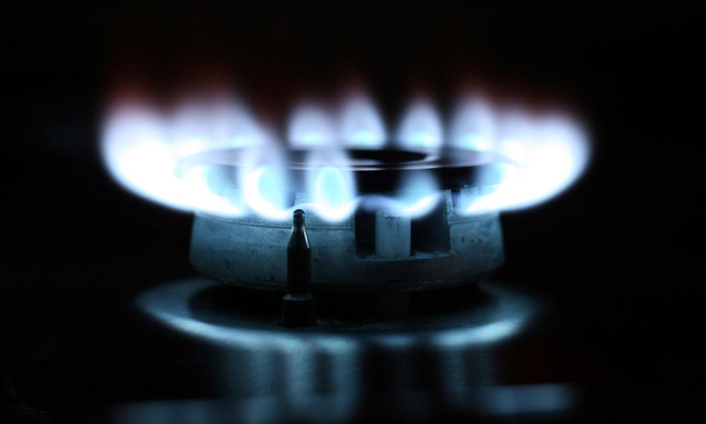 Regularly clean your gas stove's burners and range top
