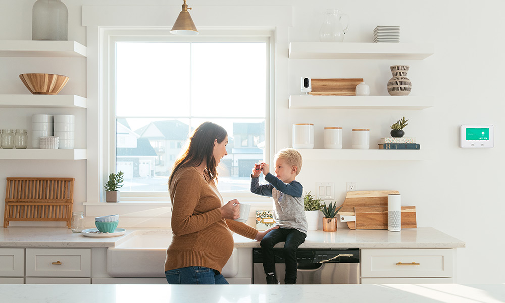 Mom and son in kitchen with Vivint Ping camera