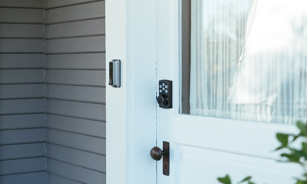Front door scene showing Vivint Smart Lock and Doorbell camera