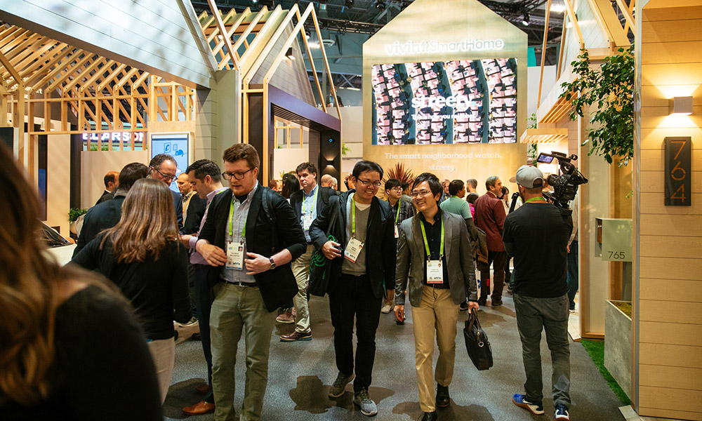CES convention-goers walk down the Vivint Smart Home booth