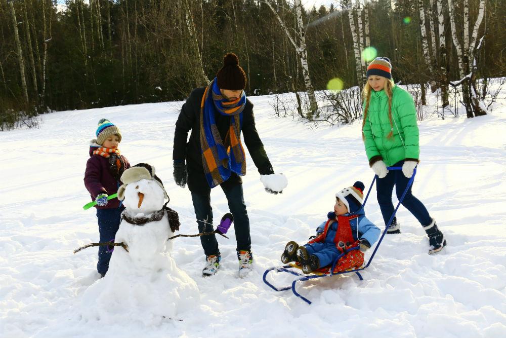 family snowman mountains