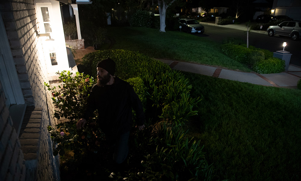 burglar in front of a house