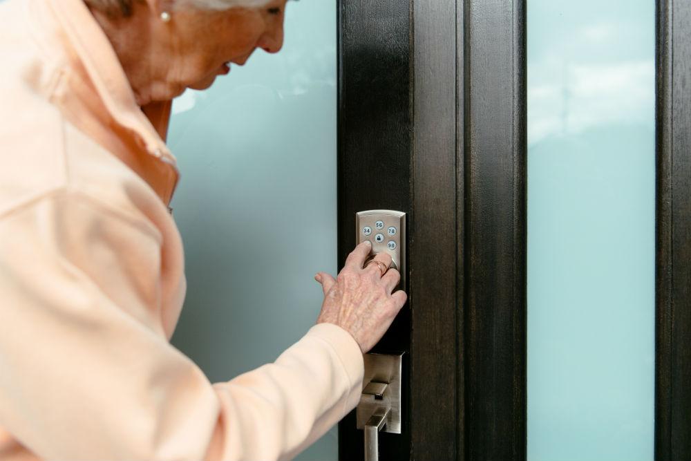Elderly woman using the Vivint Smart Lock