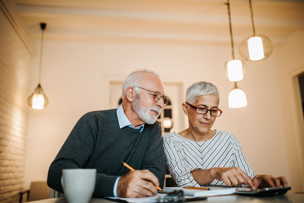 older couple budgeting financial concerns
