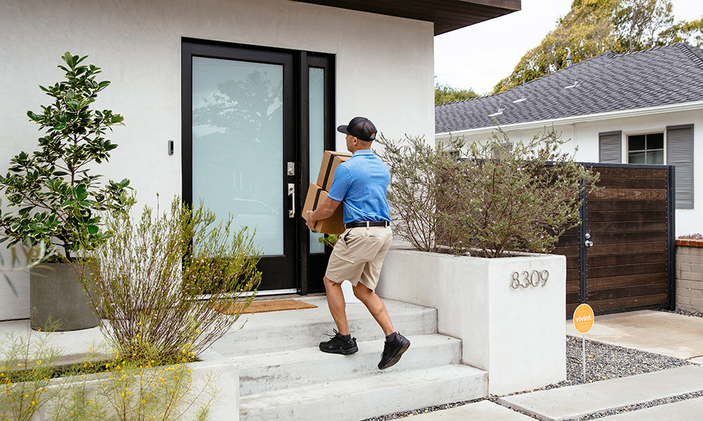 Delivery person leaving packages at a  door