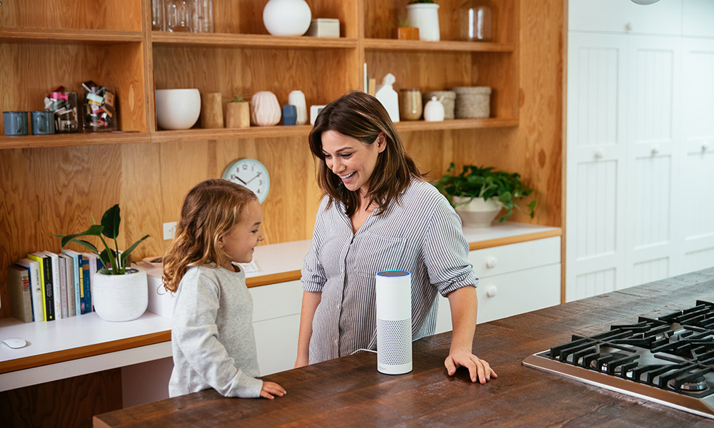 Mom and daughter using an Amazon Echo