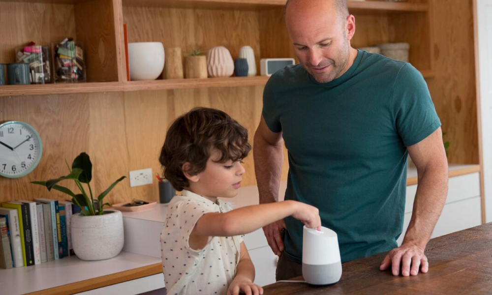 Dad and son using a Google Home
