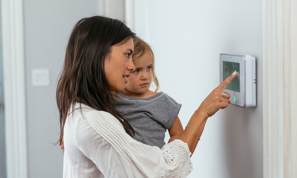 https://images.vivintcdn.com/global/vivint.com/resources/products/panel/mom-daughter-interacting-sky-control-panel.jpg