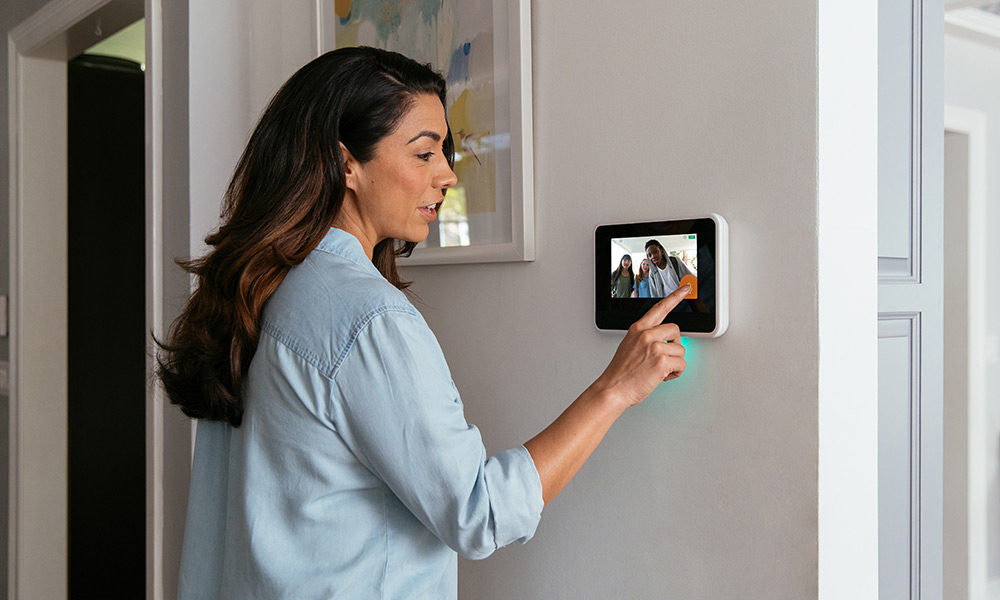 Woman interacting with her Vivint Smart Hub