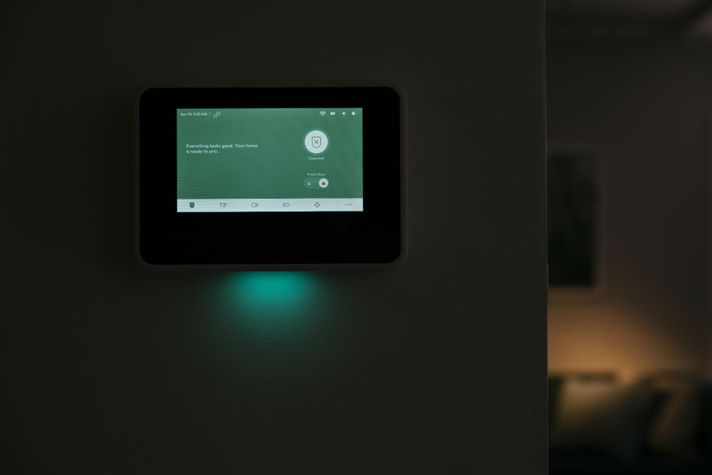 Vivint Smart Hub in a dark living room