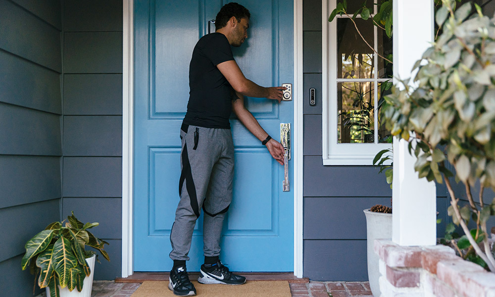man leaving home and locking door with one-touch leaving