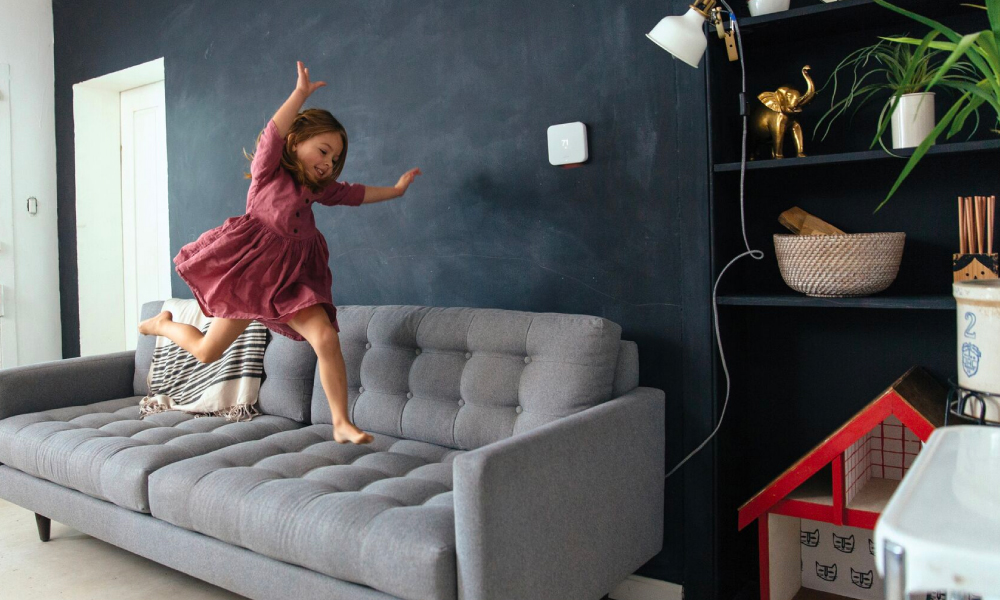 Vivint Smart Thermostat Girl Couch