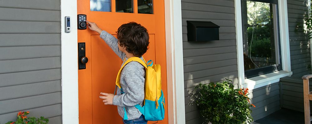 Child using the Vivint smart locks and Vivint doorbell camera